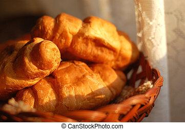 fresh croissants in basket shot in morning light