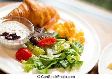 Fresh croissants with salad
