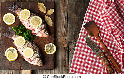 fresh crucian fish sprinkled with spices and lemon