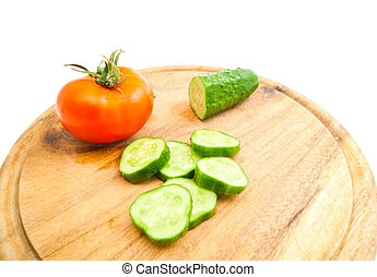 fresh cucumber and tomato on cutting board