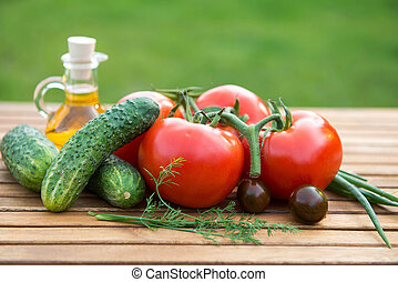 cucumber and tomatoes - fresh cucumber and tomatoes on ...