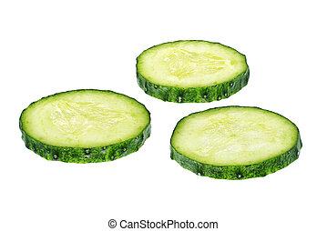 Fresh cucumber slices isolated