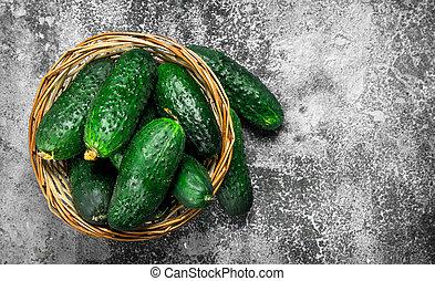 Fresh cucumbers in a basket.