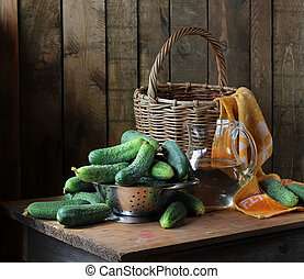 Fresh cucumbers in a colander on the table.