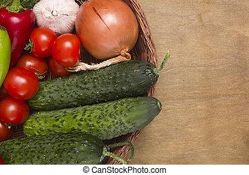 Fresh cucumbers in a wicker basket