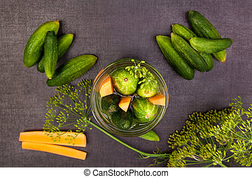 Fresh cucumbers in jar. Preserved vegetable.