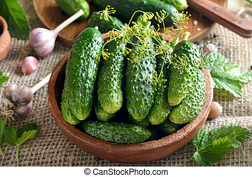 Fresh cucumbers in wooden bowl
