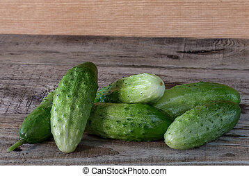Fresh cucumbers on a wooden background