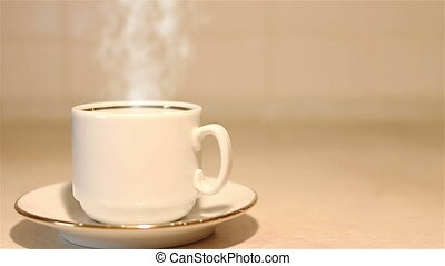 Fresh cup of coffee with steam