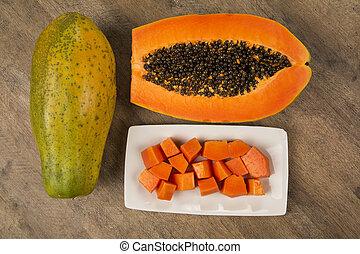 Fresh cut juicy tropical papaya mamao fruit with seeds at...