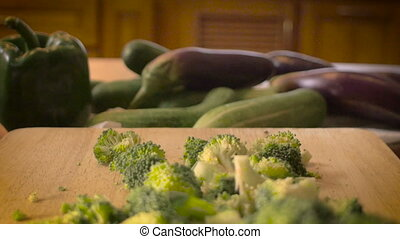 Fresh cut vegetables with broccoli on a cutting board- dolly push out