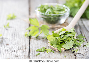Fresh cutted Lovage on vintage wooden background
