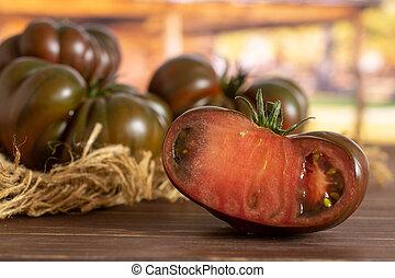 Fresh dark tomato primora with cart