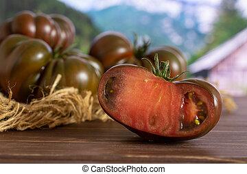 Fresh dark tomato primora with country nature