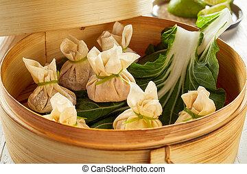 Fresh dim sum dumplings in bamboo basket