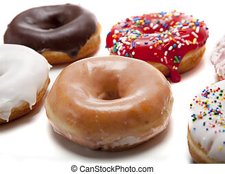 Fresh Donuts - A group of fresh decorated donuts on a white...