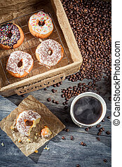Fresh donuts with coffee