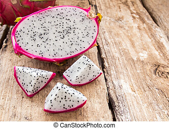 Fresh dragon fruit on wooden background