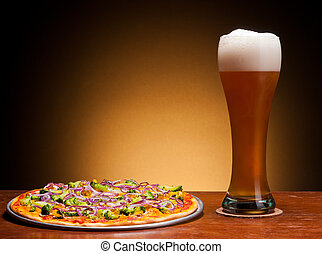 beer and pizza - fresh draught beer and pizza with...
