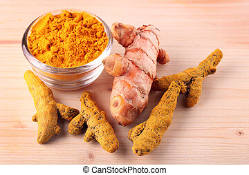 Fresh, dried and powdered turmeric root which is well known...