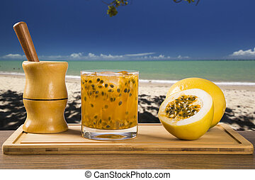 Fresh drink made with passion fruit Caipirinha in the beach...