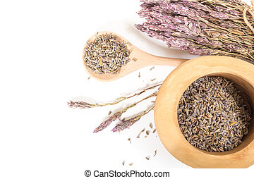 Fresh dry lavender in wooden bowl, on white background.