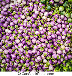 Fresh eggplants and for sale at asian market. Organic food backg
