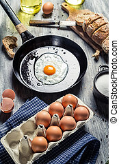 Fresh eggs for breakfast fried on a pan
