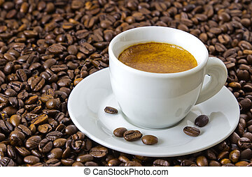 fresh espresso at roasted coffee beans - fresh espresso in a...