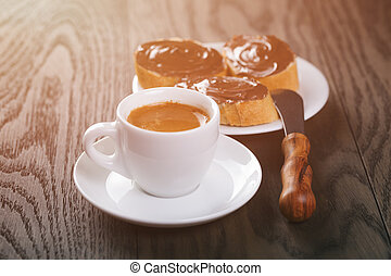 fresh espresso with baguette slices covered with chocolate cream