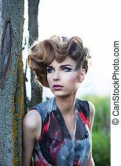 Fresh face of young beautiful sensual fashion female outdoors. Nature beauty