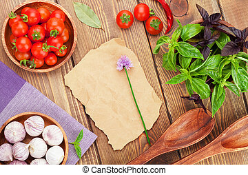 Fresh farmers tomatoes and basil on wood table. View from...