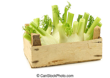 fresh fennel in a wooden crate