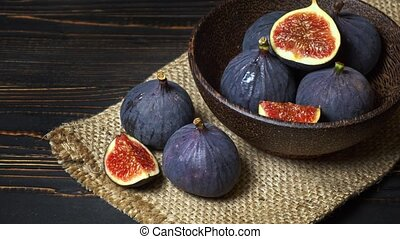 Fresh Fig isolated on wooden background - Fresh and dried...