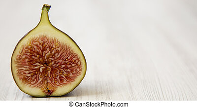 Fresh fig, side view. Close-up. Copy space.