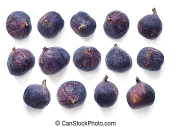 Fresh figs. Creative scheme of the whole on a white background. View top, flat lay. Copy space