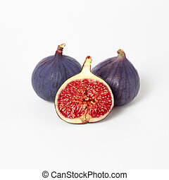 Fresh figs isolated on white background. Food Photo. Purple Fig with red seeds close up. Side view.