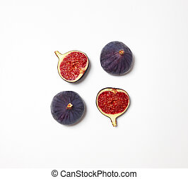 Fresh figs isolated on white background. Food Photo. Purple figs with red seeds. Flat lay, top view