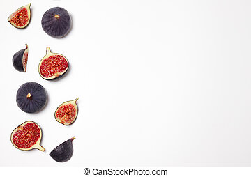 Fresh figs isolated on white background with space for text. Food Photo. Copy space. Purple figs with red seeds. Flat lay, top view