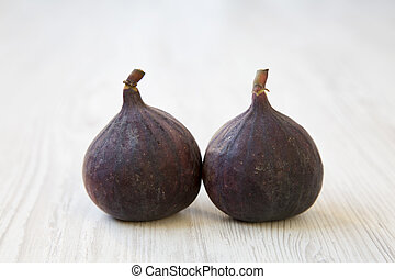 Fresh figs on a white wooden table, side view. Close-up.