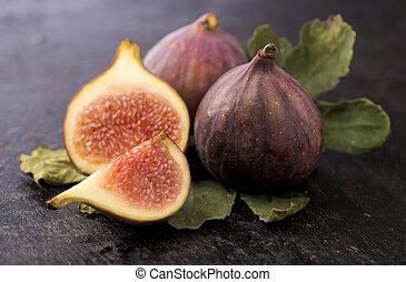 Fresh figs on black background close up