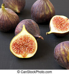 Fresh figs on black background, side view. Close-up.