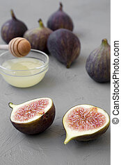 Fresh figs on concrete background, side view. Close-up.