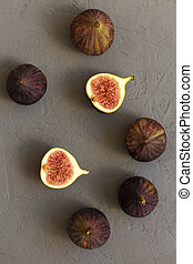Fresh figs on concrete background, top view. Overhead, from above.
