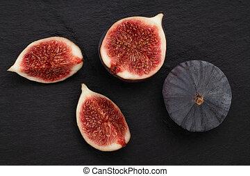 fresh figs on dark background, top view