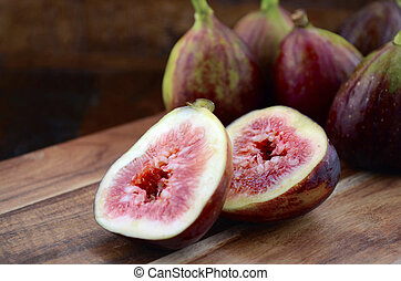 Fresh Figs on Dark Wood Table Setting.