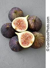 Fresh figs on gray background, top view. Close-up.