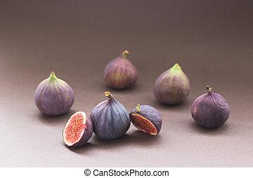 Fresh figs on grey background