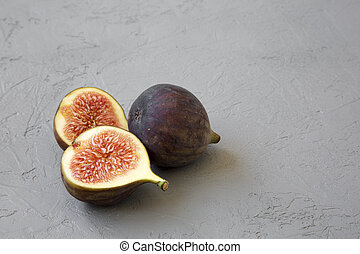 Fresh figs on grey background, side view. Close-up. Copy space.