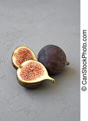Fresh figs on grey background, side view. Close-up.